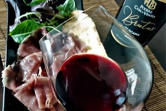 degustazione vino toscana, vino rosso e carpaccio